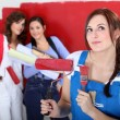 Three female friends painting wall — Stockfoto #9061016