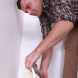 Man about to pour some plaster — Stock Photo