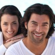 Head and shoulders shot of a well matched couple in white — Stock Photo