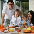 Stock Photo: Family having breakfast outdoors