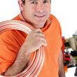 Workers with shoulder roll tube — Stock Photo