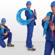 Blue collar with hard hat carrying hose on his shoulder - Stockfoto
