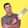Stock Photo: Mholding hand saw