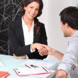 Two shaking hands over a contract — Stock Photo