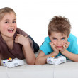 Children playing a games console — Stock Photo