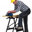 Stock Photo: Craftsmworking on wooden board