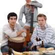 Stock Photo: Young men with musical instruments