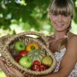 Woman holding wicker basket — Stock Photo