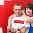 Couple painting room in red — Stock Photo