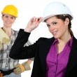 Stock Photo: Women with construction helmets