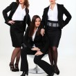Three sexy business women — Stok fotoğraf