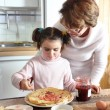 Woman and child making pancakes — Stock Photo