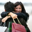 Woman thanking man for presents with hug — Stock Photo