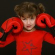 Little girl with boxing gloves — Stock Photo