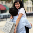 Couple hugging during shopping trip — Stock Photo