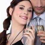 Couple having a celebratory drink — Stock Photo