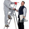 A painter and a tiler. - Stock Photo