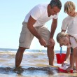 Family playing in the sea — Stock Photo