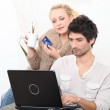 Young couple shopping online with bank card — Stock Photo