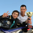 A young biker with a trophy. — Stock Photo