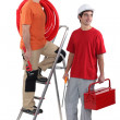 Two plumber ready to get stuck in - Stock Photo