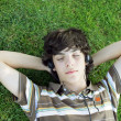 Teen lying on the grass - Stock Photo