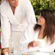 Couple dressed in bathrobe at breakfast — Stock Photo