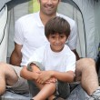 Father and son camping together — Stock Photo