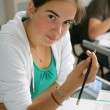 Stock Photo: Teenage girl writing in exam
