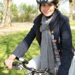 Smiling woman having a bike ride — Stock Photo