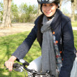 Stock Photo: Smiling womhaving bike ride