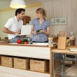 Young man and young woman smiling in kitchen — Stock Photo #9066612