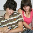 Teenage couple hanging out at home — Stock Photo