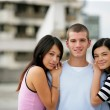 A teenage boy surrounded by girls - Stock Photo
