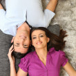 Couple laying on rug — Stock Photo
