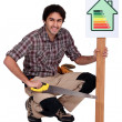 Stock Photo: Carpenter promoting energy savings.