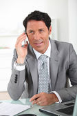 Businessman on the phone smiling — Stock Photo