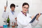 Laboratory workers testing wine — Stock Photo