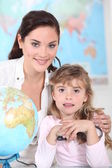 Little girl and her teacher posing together — Stock Photo