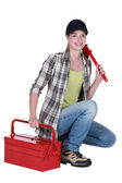 Female plumber with wrench and tool kit — Stock Photo