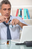 Office worker suffering from hangover — Stock Photo