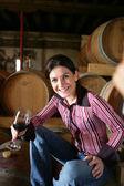 Women in wine cellar with wine glass — Stock Photo