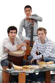 Young men with musical instruments — Stock Photo