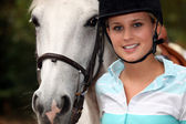Young girl with horse — Stock Photo