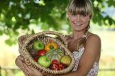 Woman holding wicker basket — Stock Photo