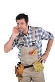 Craftsman telling a secret — Stock Photo
