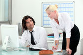 Attractive couple working in an office — Stock Photo