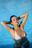 Woman in a swimming-pool — Stock Photo