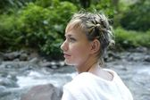 Blond woman posing by stream — Stock Photo