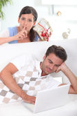 Surprising boyfriend with gift — Stock Photo